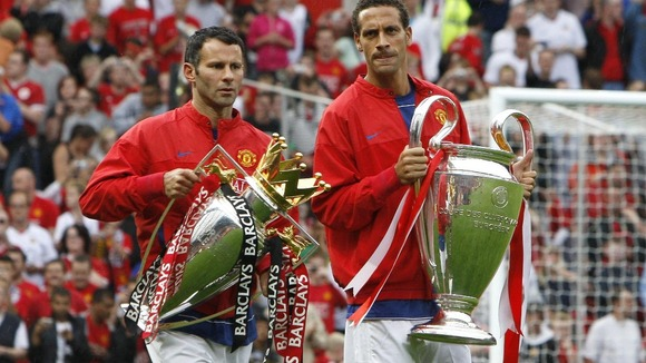 Manchester United's Ryan Giggs (left) and Rio Ferdinand with the Permier League and Champions League trophies in 2008.