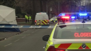 Several police cars on the scene after body found in Chorlton.