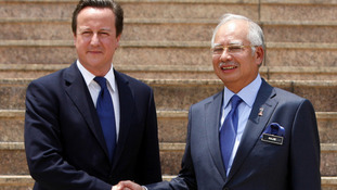 David Cameron shakes hands with his Malaysian counterpart Najib Razak during a welcoming ceremony in Putrajaya, Malaysia.