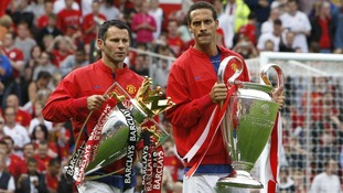 August 2008. Manchester United's Ryan Giggs (left) and Rio Ferdinand with the Premier League and Champions League trophies in 2008.