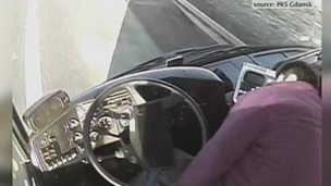 The bus driver slumps in his seat before falling to the floor in the video.