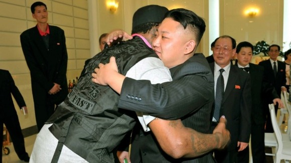 Dennis Rodman and North Korean leader Kim Jong-un pictured hugging.