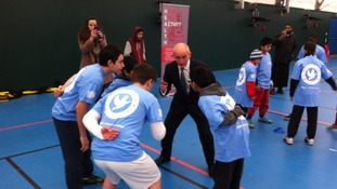 Barry McGuigan with some children attending the opening of the Take 12 Challenge