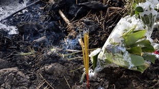 Flowers and incense are laid at the site of the hot air balloon crash in Luxor, Egypt
