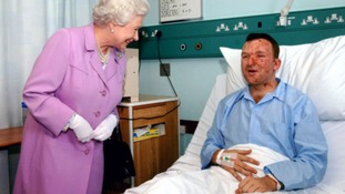 The Queen meeting Bruce Lait the day after the London bombings in 2005.