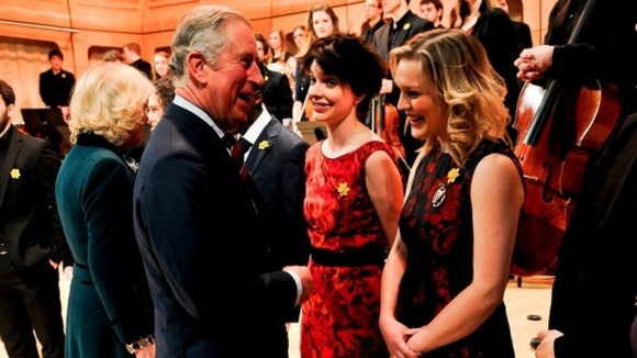 The Prince of Wales meets Hannah Stone, current harpist to the Prince, with Catrin Finch (right), the first harpist to the Prince