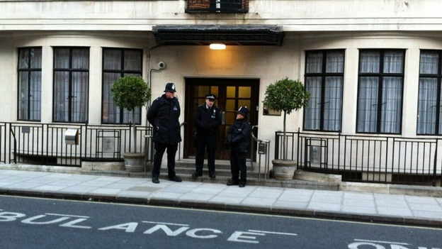 Police officers stand guard outside the King Edward VII Hospital