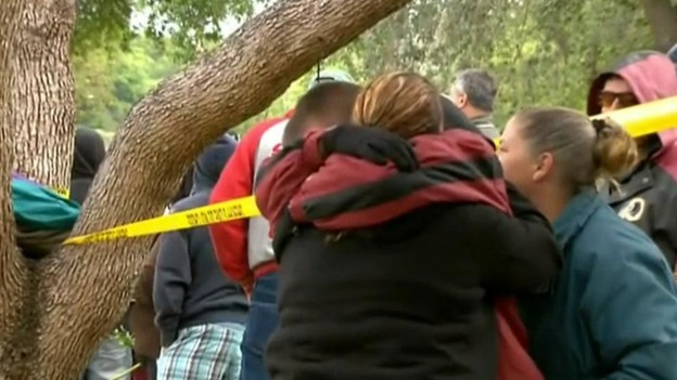 Neighbours and relatives console each other in Tampa, Florida
