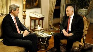 John Kerry meets the Egyptian President Mohammed Morsi