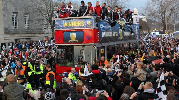 Swansea City parade the Capital One Cup through the streets of Swansea.