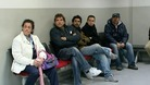 People wait to be seen at an unemployment office in Spain