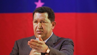 President Hugo Chavez greets supporters during a campaign rally in Caracas last year