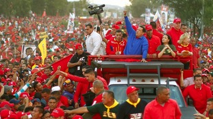 Venezuela's President Hugo Chavez speaks in the rain during his closing campaign rally in Caracas last year