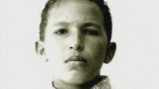 A young Hugo Chavez stares down the lens