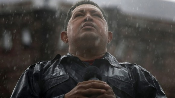 Hugo Chavez speaks in the rain during his closing campaign rally in Caracas in October 2012