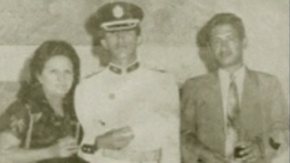 Hugo Chavez with his parents Elena and Hugo during his years at the Military Academy