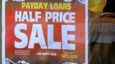 A poster advertising a payday loan 'sale'