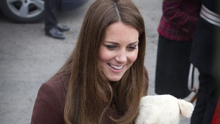 The Duchess of Cambridge accepts a teddy bear from the crowds in Grimbsy - but is it for a boy or a girl?