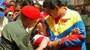 Venezuela's Vice President Nicolas Maduro consoles a mourner