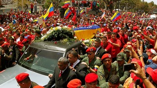 The coffin of President Hugo Chavez is driven through the streets of Caracas