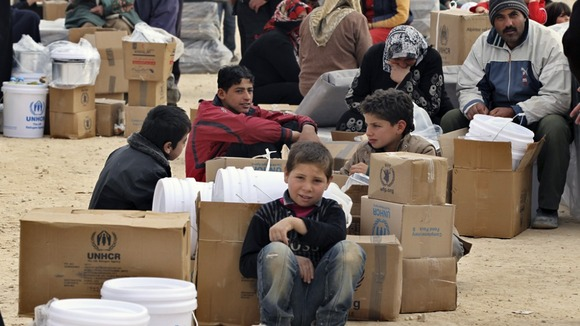 Newly arrived Syrian refugees wait to receive aid and rations at Al-Zaatri refugee camp in the Jordanian city of Mafraq in January
