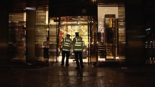 Police around the entrance to the Gucci store in Sloane Square