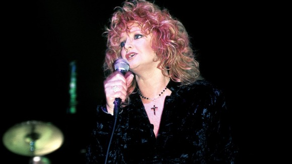 Welsh rock singer Bonnie Tyler performing on stage at a charity gig for Unicef at London's Astoria in 1996