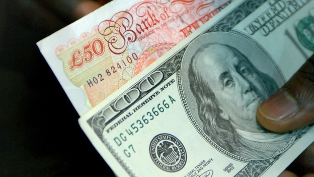 Pound rallies against the dollar after QE decision