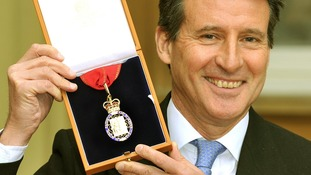 Lord Coe holds his Companions of Honour award