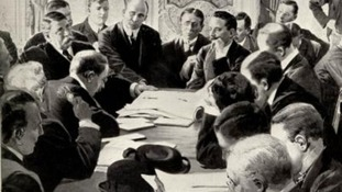 Men sitting round a table