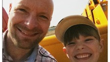 Finn Robinson, 8, with dad Adam.