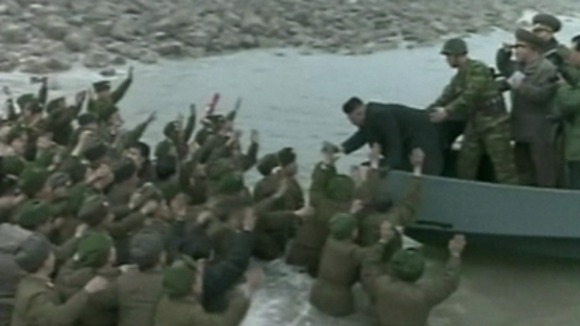 Soldiers cheer Kim Jong-un as he leaves the military base