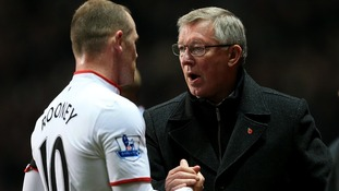 Manchester United manager Sir Alex Ferguson and Wayne Rooney last year