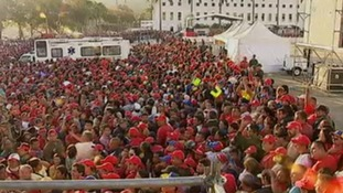 A massive crowd has gathered outside the Military Academy where the body of Hugo Chavez has lain in state since his death