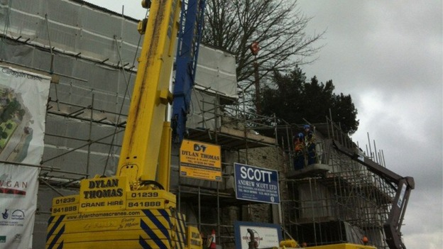 Crane removing first of stanchions support Cardigan Castle