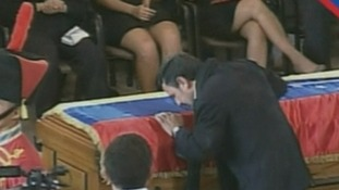 Iran's President Mahmoud Ahmadinejad kisses the coffin
