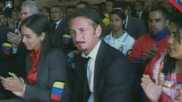 Sean Penn listening to the Reverend Jesse Jackson