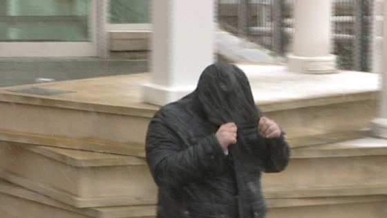 Russell Yates hid his face when he left court after being found guilty last month