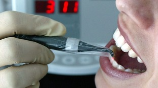 A dentist carries out treatment