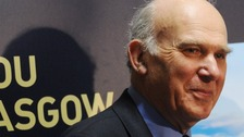 Business Secretary Vince Cable tours the exhibition stands at the Liberal Democrat spring conference
