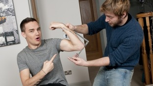 A sculptor measuring Liam's arm