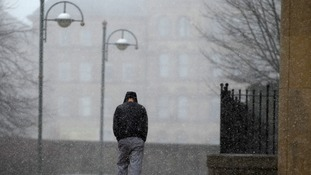 A man battles against the weather conditions in Bradford today.