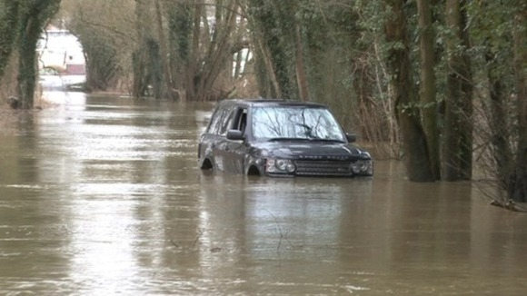 A car that got trapped in floods in Norfolk