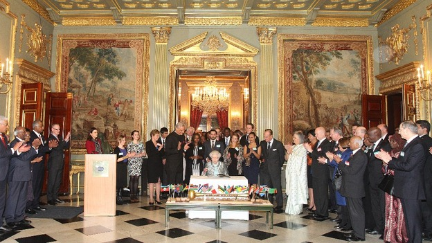 Queen Elizabeth II, Head of the Commonwealth signs the Commonwealth Charter at a reception at Marlborough House.