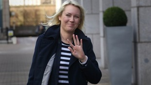 Stella English waves to photographers as she arrives at East London Tribunal Courts