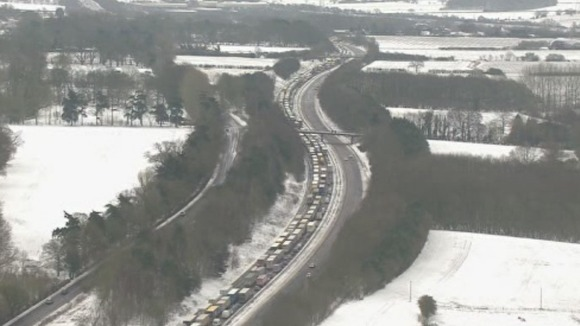 Traffic can be seen queuing for miles because of the poor weather conditions