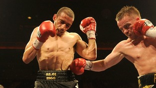 Curtis Woodhouse is punched by Frankie Gavin during the WBO Intercontinental Welterweight Championship bout in 2011