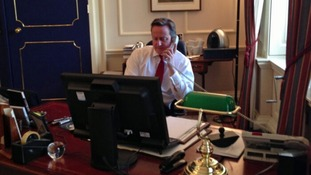 David Cameron speaking by phone to Gavin Short