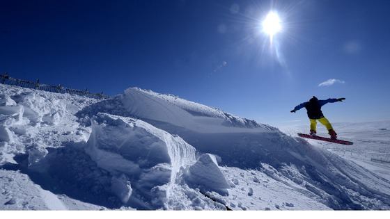 A snow boarder makes a jump at the Yad Moss ski slope in Cumbria near Alston.