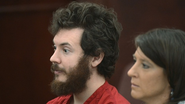 James Holmes listens with public defender Tamara Brady at his arraignment in Centennial, Colorado